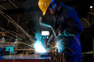 bigstock-worker-making-sparks-while-wel-